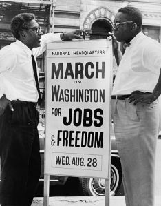 1963: In front of 170 W 130 St., March on Washington, [l to r] Bayard Rustin, Deputy Director, Cleveland Robinson, Chairman of Administrative Committee